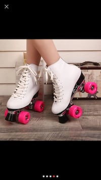 pair of white rollerblades Laval, H7N 2Y9