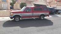red and white extra cab pickup truck with camper shell Las Vegas, 89128