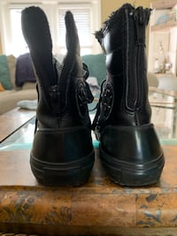 Gently used black converse boote Crestview, 32539