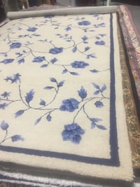 White, blue, and brown floral area rug