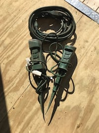 Two green power tools with black coated wire