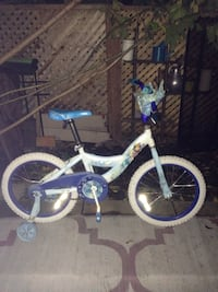Huffy girls bicycle with training wheels Mississauga, L5J 1V8
