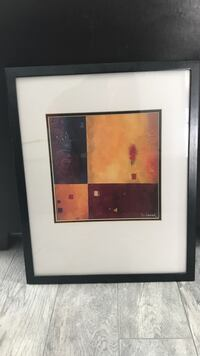 abstract painting with black wooden frame