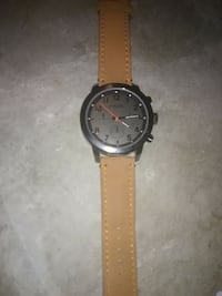 round black analog watch with brown leather band