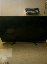 black flat screen TV with remote New York, 10029