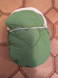 green and white camping chair