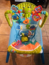 Baby's blue and green fisher-price bouncer Montréal, H1K 2S6