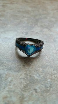 Black plated CZ with blue stone...size 7