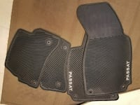 four black Volkswagen Passat vehicle mats.  Alexandria