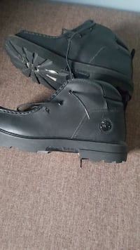 pair of black leather boots $ 50