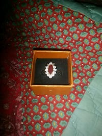 gold-colored red and clear gemstone encrusted marquis cut ring with box Wayne County, 28333