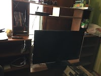 Black wooden tv hutch with flat screen television Coos Bay, 97420