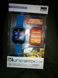 blue and red digital watch in box