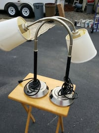 white and black metal base table lamp