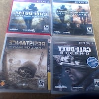 four assorted PS3 game cases Mounds