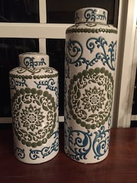 "Two white-and-green floral ceramic vases. 14.5"" and 10.5"" height  Coral Gables, 33134"