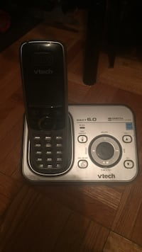 black and silver Vtech Dect 6.0 wireless telephone