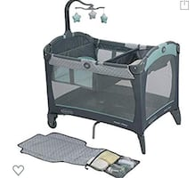 Graco pack and play, change n carry playard  manor