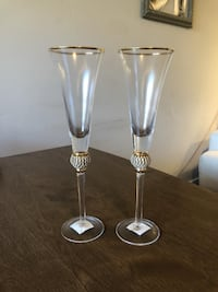 two stainless steel candle holders WASHINGTON