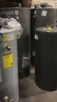 Four grey electric water heaters Springfield