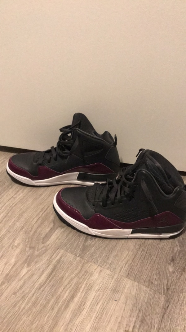 pair of black-and-purple Air Jordan shoes 4c1a3f3e-c439-482f-aa6a-9774bee14b90