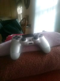 white Sony PS4 game console with controller Manassas, 20110