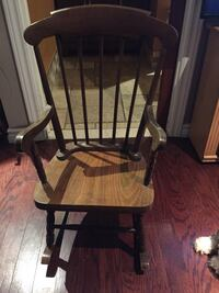 Brown wooden child's windsor rocking chair.    still available Prince Edward, K8N