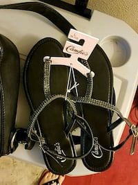 pair of black-and-white sandals Chico