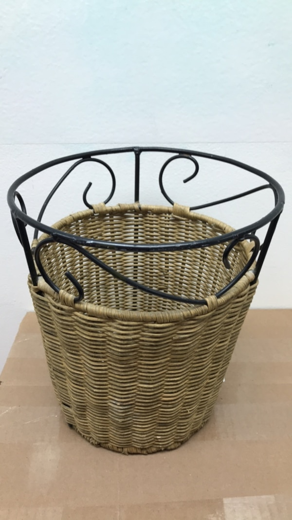 small wicker and metal trash can