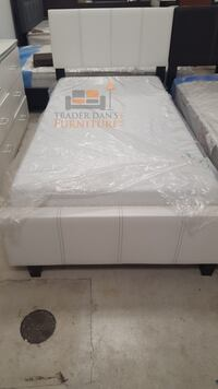 Brand new twin size platform bed frame with mattress  39 km