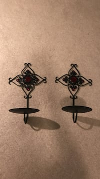 Two black candle sconces