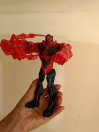 black and red monster character action figure