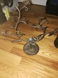 brown tree-themed steel candle holder