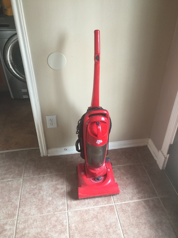 red and black upright vacuum cleaner