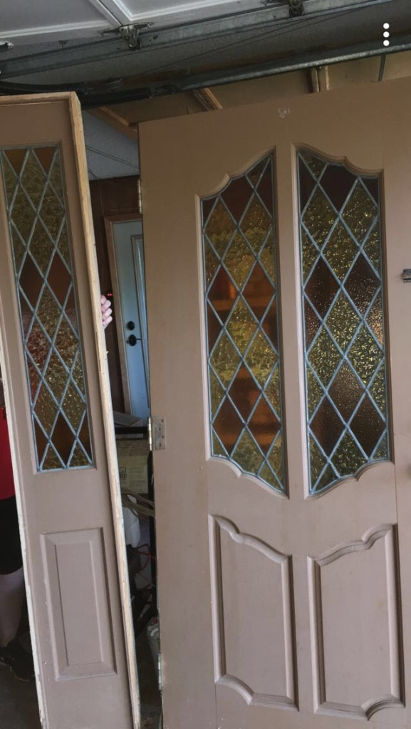 Photo Solid wood stained glass front door and side light