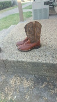 pair of brown leather cowboy boots Dallas, 75229