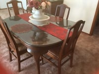 MOVING SALE!!! Antique table and 8 chairs, one is captin chair.