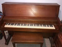 brown wooden upright piano with chair Winchester, 22603