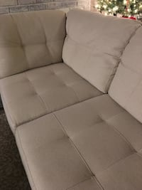 white fabric tufted sectional sofa