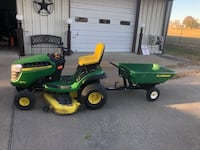 green and yellow John Deere ride-on mower Richardson, 75082