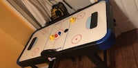 White and black air hockey table Alexandria, 22308