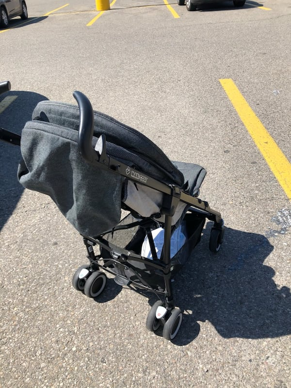 Fold up umbrella stroller. Great for travel 1