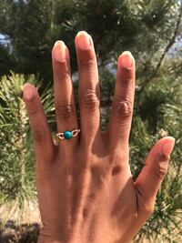 gold-colored ring with teal gemstone Colorado Springs, 80916