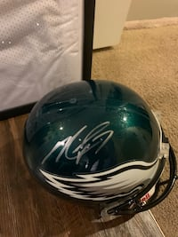 Michael Vick jersey and autograph helmet with papers