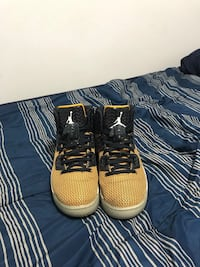 pair of black-and-brown Nike basketball shoes