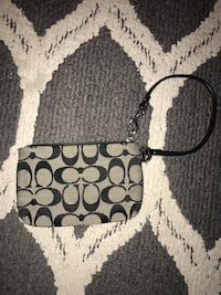 Gray and black coach monogram wristlet