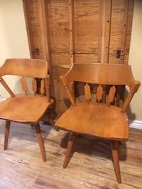8 brown wooden chairs w/table