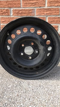 Black bullet hole car wheel with tire on as is basis. 14 inch used in Pontiac 2001 Toronto, M1P 4W1