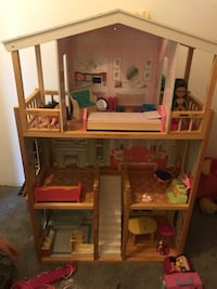 brown and pink wooden dollhouse 46 km
