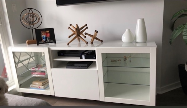 white wooden TV stand with flat screen television